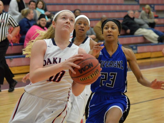 Oakland's Shelby Jane Petty goes up for a layup against La Vergne during the Lady Patriots' 58-6 win Tuesday night.
