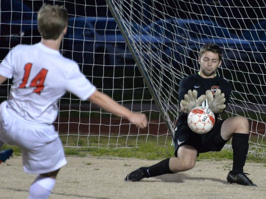 Oakland goalkeeper Jakob Hurst stops Jonathan Sneed's shot. He was the District 7-AAA Co-Goalkeeper of the Year.