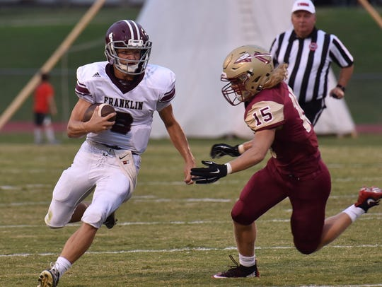 Riverdale's Brady Stokes pursues Franklin QB Wes Patterson