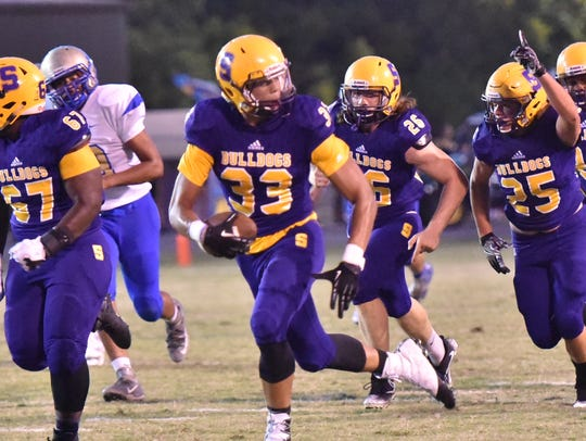 Smyrna's Tevin Shipp (33) heads for the end zone on