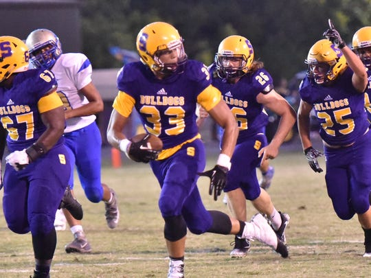 Smyrna's Tevin Shipp (33) heads for the end zone on one of his two defensive returns for scores during Friday's win over Smyrna.