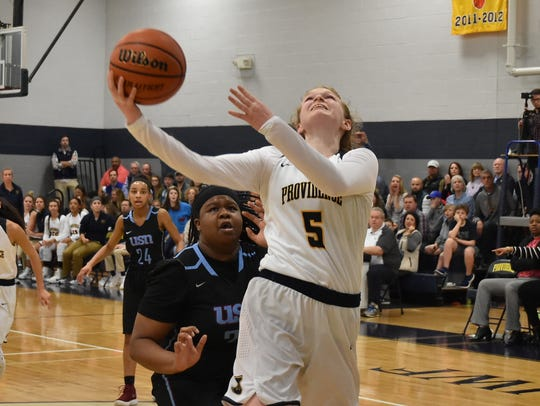 Providence Christians A.C. Markham goes in for a layup during Tuesday's 42-40 win over USN in the region quarterfinals.