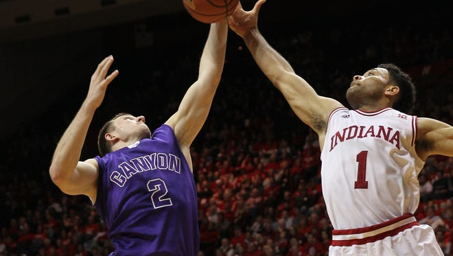 Grand Canyon Antelopes guard Joshua Braun (2) and Indiana Hoosiers guard James Blackmon Jr. (1) go up for a rebound during a Dec. 13 game in Bloomington, Ind. Indiana defeated Grand Canyon 94-66.