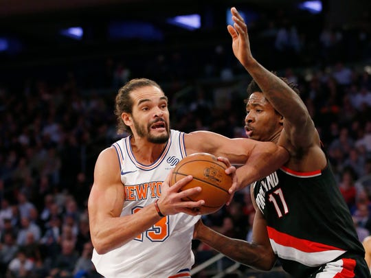 New York Knicks center Joakim Noah (13), making his season debut after a suspension for performance enhancing drugs, goes up against Portland Trail Blazers forward Ed Davis (17) during the first half of an NBA basketball game in New York, Monday, Nov. 27, 2017. (AP Photo/Kathy Willens)