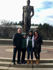 Brian Gregory poses in front of the Sparty statue with