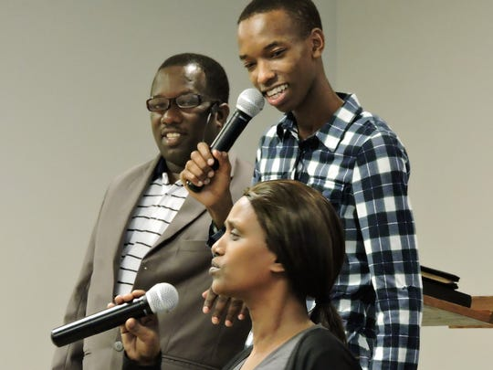 Members of the African Fellowship of Oshkosh and the Fox Valley pray and worship together.