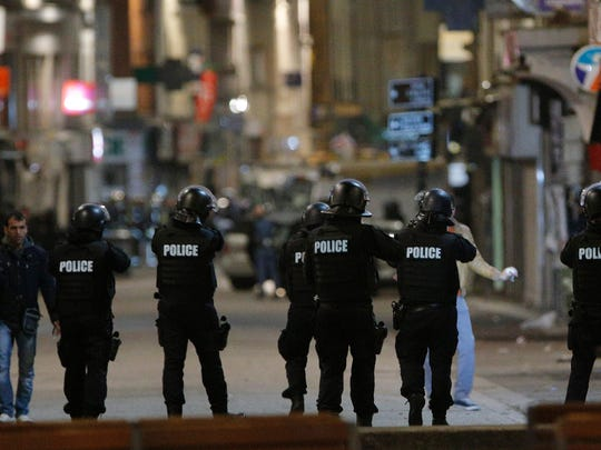 Police forces prepare in St. Denis, a northern suburb