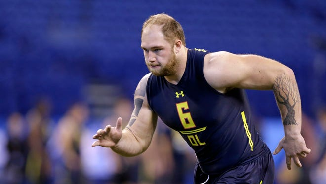 Michigan offensive lineman Ben Braden runs a drill at the NFL scouting combine in Indianapolis on March 3, 2017.