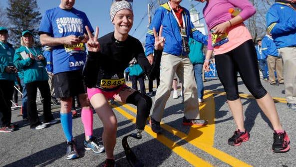 Boston Marathon bombing survivor Adrianne Haslet, center,