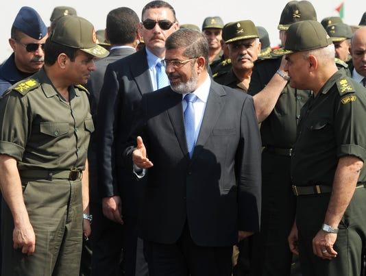 U.S. cuts Egypt military aid, won't end it