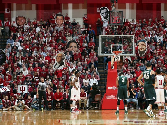 Indiana fans wave large fatheads in an attempt to distract MSU's Alvin Ellis III (3) as he shoots a free throw on March 7 at Assembly Hall in Bloomington, Ind. Ellis made 2 of 5 as his team went 11 of 20 from the line. However, the Spartans held on to win, 74-72.