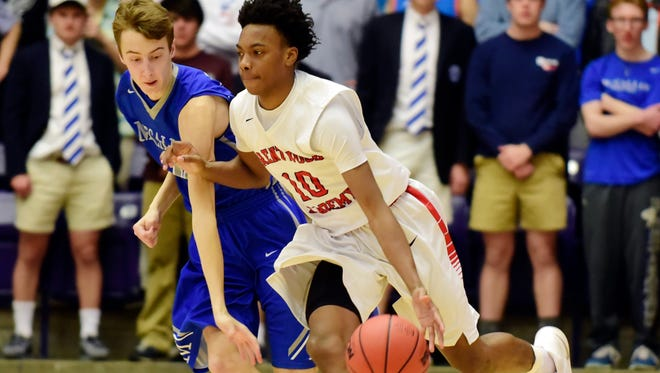 Brentwood Academy's Darius Garland (R) drives past McCallie School's Henley Edge (L) during the second half of the Tennessee Division II AA boys' high school basketball championship game Saturday, March 4, 2017, in Nashville, Tenn. (AP Photo/Mike Strasinger)