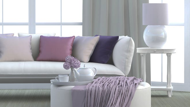 Accent pillows and throws are inexpensive elements that change the look of a room.