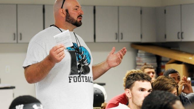 Bayside's Mike Nahl, pictured here talking to his team, has resigned as head football coach.