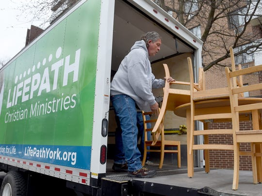 Richard Noll, representing Lifepath Christian Ministries, unloads furniture to be delivered to an apartment complex on North Duke Street on Tuesday, March 21, 2017. Noll, who has struggled with alcohol and marijuana use for years, is part of a new program which works with law enforcement and the offenders to help him get clean.