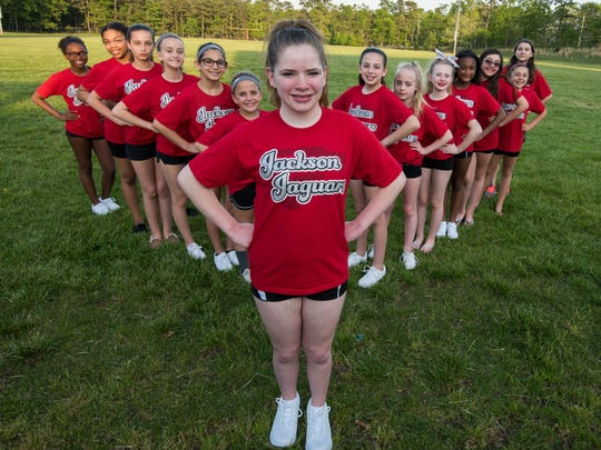 """5/17/17- Jackson NJ, Isabella """"Bella"""" Hope Georgiano , 12 of Jackson  (center ) a member of the Jackson Jaguars Division 12 Large Red Cheer team poses with her team."""
