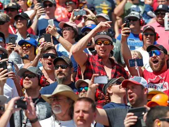 Fans celebrate as the Ticket Guardian 500 NASCAR race
