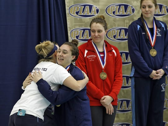 West York's Courtney Harnish, right, gets a hug from