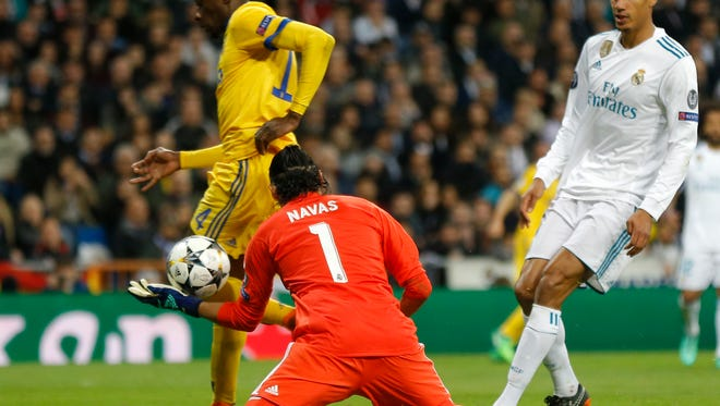 Juventus' Blaise Matuidi scores his team's third goal past Madrid goalkeeper Keylor Navas.