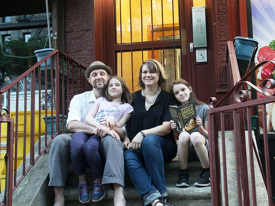 Daniel Friedman, Lora LaVon and their daughters, Thalia, 8, left, and Binah,11, outside their Manhattan apartment building.