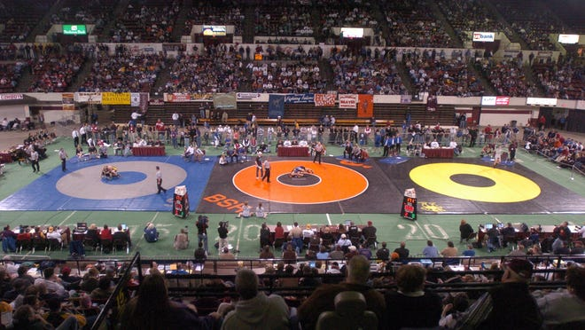 Championship night at the All-Class Wrestling Tournament in Billings features three mats and huge crowds at the Billings Metra.