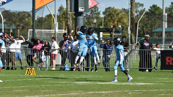 Royal Palm Beach Wildcats players celebrate a touchdown during their 12-8 win over the Stratford Redskins in the 12-and-under Pop Warner SuperBowl last month.