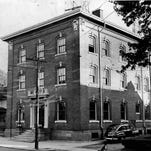 UP FOR AUCTION - This long abandoned Bronson avenue police station building will be auctioned Dec. 12, 1956) (Staff photo, 11/1956) TU 11/29/1956