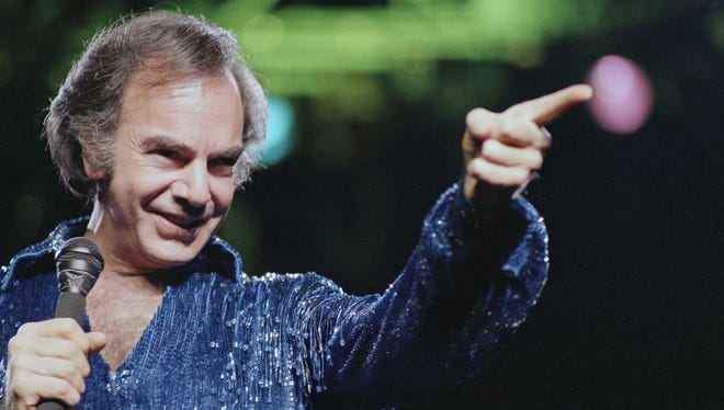 Neil Diamond gestures during a performance at New York's Madison Square Garden on July 24, 1986.