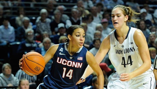 Connecticut's Bria Hartley (14), driving on Penn State's Tori Waldner, tied a career high with 29 points.