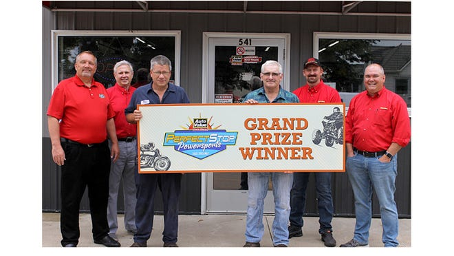 Grand Prize Winner, Sleepy Eye Repair, in a congratulatory photo, from left: Tim Cordell, commercial sales manager at Auto Value; Dan Hopkins, regional manager at Auto Value; Dan Neid and Pete Schumacher, winners and co-owners of Sleepy Eye Repair; Tim Cleveland, store manager of Sleepy Eye Auto Value; and Corey Bartlett, president and CEO of Automotive Parts Headquarters Inc.