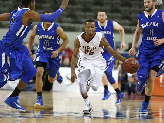 IUPUI's P.J. Boutte moves the ball up the court as he is surrounded by Indiana State players during the first half of the game at the Fairgrounds Coliseum Friday November 14, 2014.