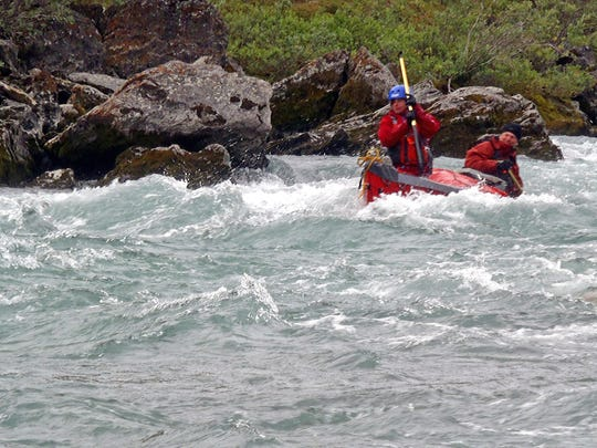 Aidan Campbell, in the bow, and her father, James Campbell, navigate a Hulahula River rapids in northern Alaska in summer 2014.
