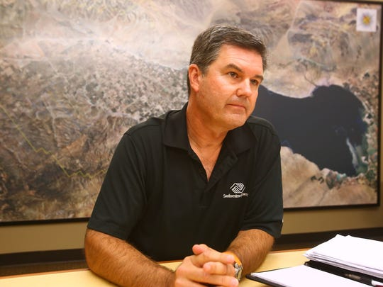 John Powell Jr., president of the Coachella Valley Water District's board, discusses a plan to raise rates at the agency's office in Palm Desert.