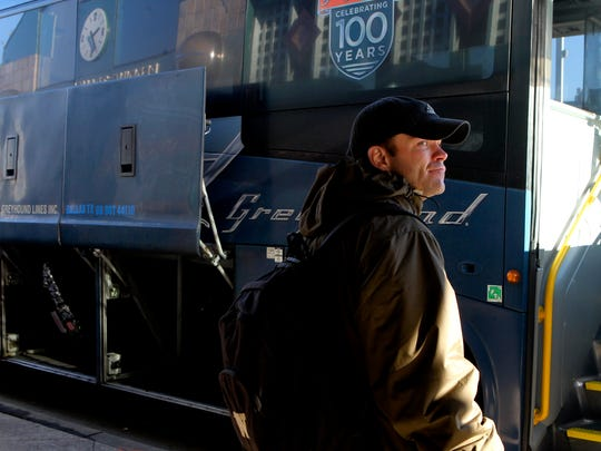 FILE PHOTO - Allen Johnson prepares to board a Greyhound bus Christmas morning, 2014, for a trip to Colorado Springs, Colo.