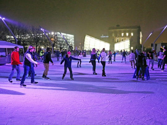 Guests enjoy the ice rink during the 16th annual Holiday Promenade in the Historic East Village of Des Moines on Friday, Nov. 17, 2017.  The festive event features boutique shopping, free ice skating at the Brenton Skating Plaza, caroling, tree lighting, a visit from Santa, live ice sculpting, and free horse-drawn trolley rides.