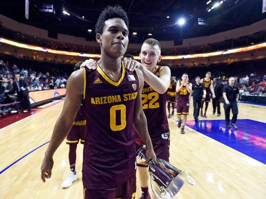 ASU guard Tra Holder walks off the court after Saturday's win over Xavier in Las Vegas.