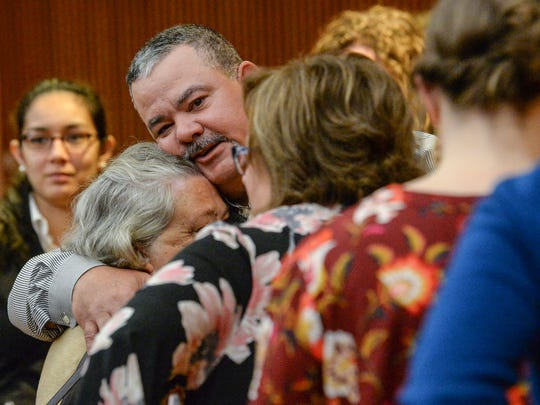 Jamie Brock, firefighter who held down Jesse Osborne at Townville Elementary on September 28, 2016, hugs a member of the Hall family during a lunch break at waiver hearing for Jesse Osborne at the Anderson County Courthouse on Tuesday, February 13, 2018.