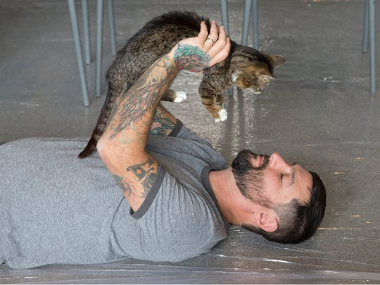Lil Bub and her owner Mike Bridasky enjoy a meet and