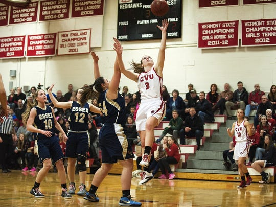 CVU's Sadie Otley (3) leaps past Essex's Josina Munson