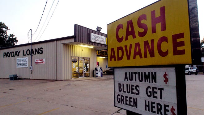 File photo taken in 2006 depicts the Show Me the Money payday lending location in Bossier City, La.