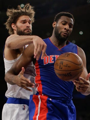 Pistons center Andre Drummond and Knicks center Robin Lopez battle for a rebound during the first quarter.