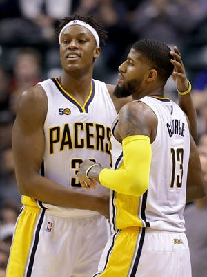 Indiana Pacers forward Paul George (13) gets a hug Myles Turner (33) after George hit a three-point shot and was fouled in the second half of their game  Wednesday, March 15, 2017, evening at Bankers Life Fieldhouse. The Indiana Pacers defeated the Charlotte Hornets 98-77.