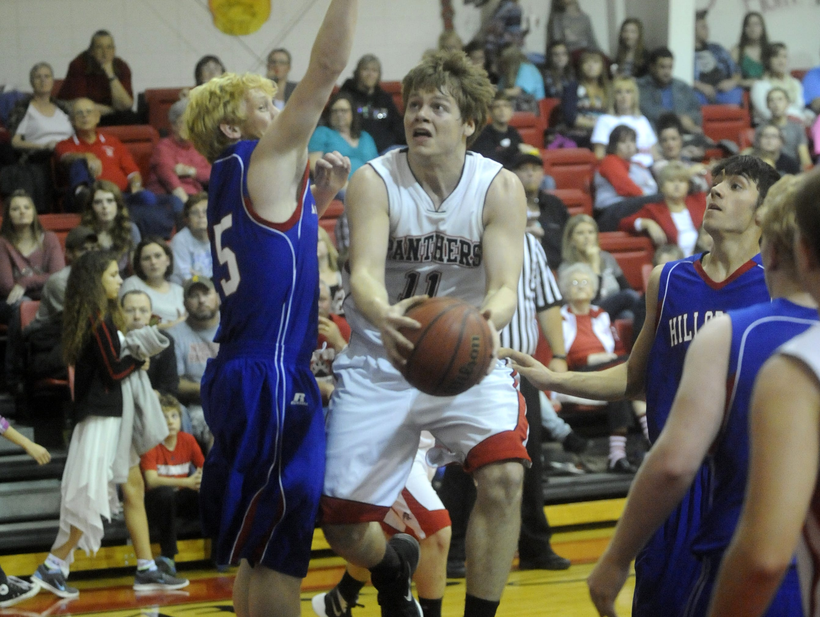 Norfork's Travis Lewis goes up for two during the Panthers' 51-18 win over Hillcrest on Friday night.