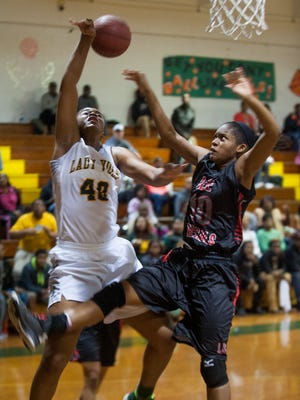 Jeff Davis' Jasmine Walker (40 is fouled by Lee's Tamaya Riley (10) at the JD campus in Montgomery, Ala. on Wednesday February 10, 2016.