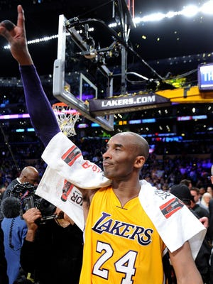 Kobe Bryant salutes the crowd after his final NBA game April 13, 2016 at Staples Center in Los Angeles. Bryant scored 60 points in a 101-96 Lakers victory against the Jazz.