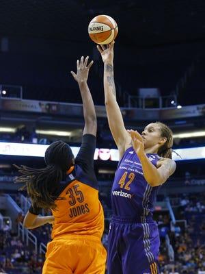Phoenix Mercury center Brittney Griner (42) shoots  against Connecticut Sun forward Alyssa Thomas (25) during the second half of their WNBA game Wednesday, June 29, 2016 in Phoenix.