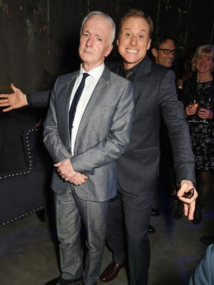 C-3PO actor Anthony Daniels feigns annoyance as K-2SO star Alan Tudyk smiles hard while promoting the film in London.