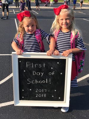 Matching first grade siblings Gabby and Izzy Oyler are all smiles on their first day of school at Madeira Elementary School on Aug. 16.