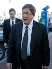 Nephi Jeffs, left, and his brother Lyle leave the federal courthouse in Salt Lake City on Jan. 21, 2015. Lyle Jeffs remains a fugitive in the federal prosecution of polygamists in the Utah-Arizona stateline communities of Hildale and Colorado City who are accused of illegally transferring their food stamps to their church for redistribution.