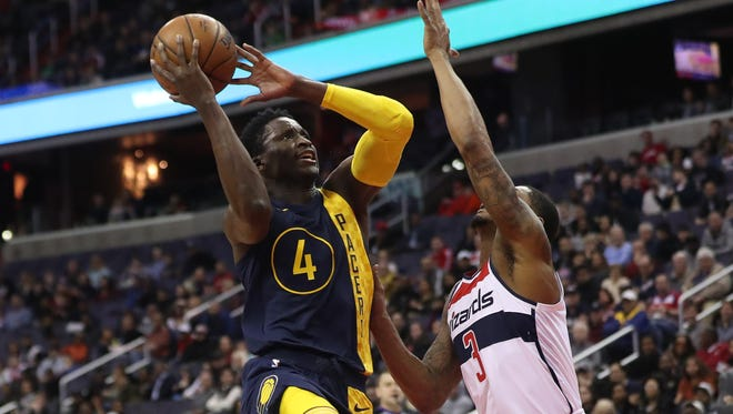 Indiana Pacers guard Victor Oladipo (4) shoots the ball over Washington Wizards guard Bradley Beal (3) in the first quarter at Capital One Arena.